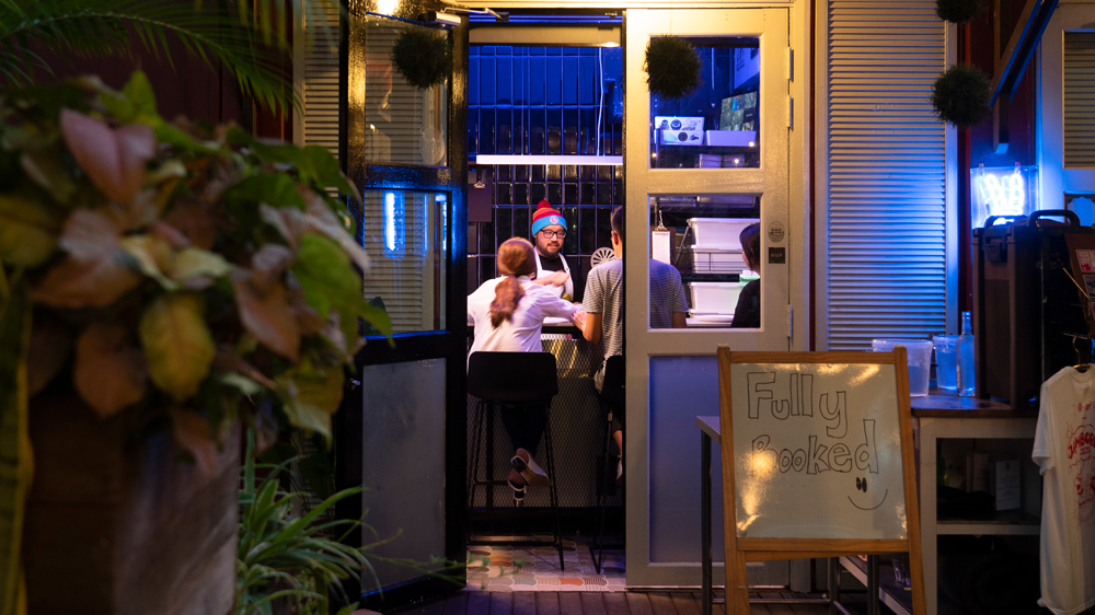 Eating pizza at Small's, Singapore's smallest restaurant 56