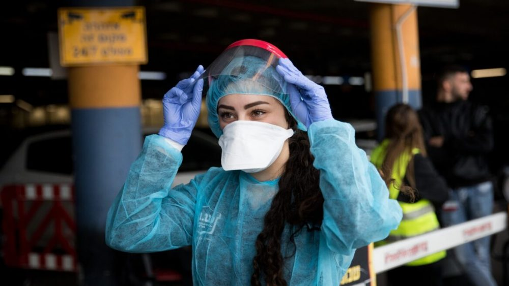 Eye-shields and high-grade masks are worn together with protective suits. News Asia Today