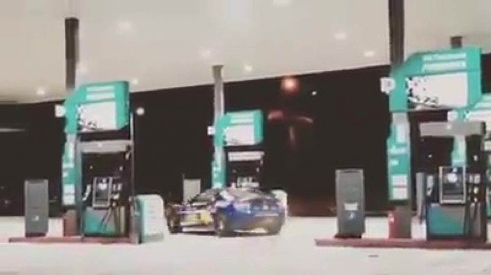 2 men drifting Subaru Petrol Kiosk News Asia Today