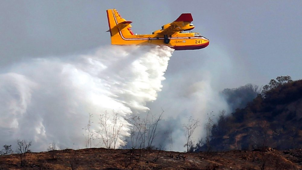 Water bombing to put out fires in affected areas.