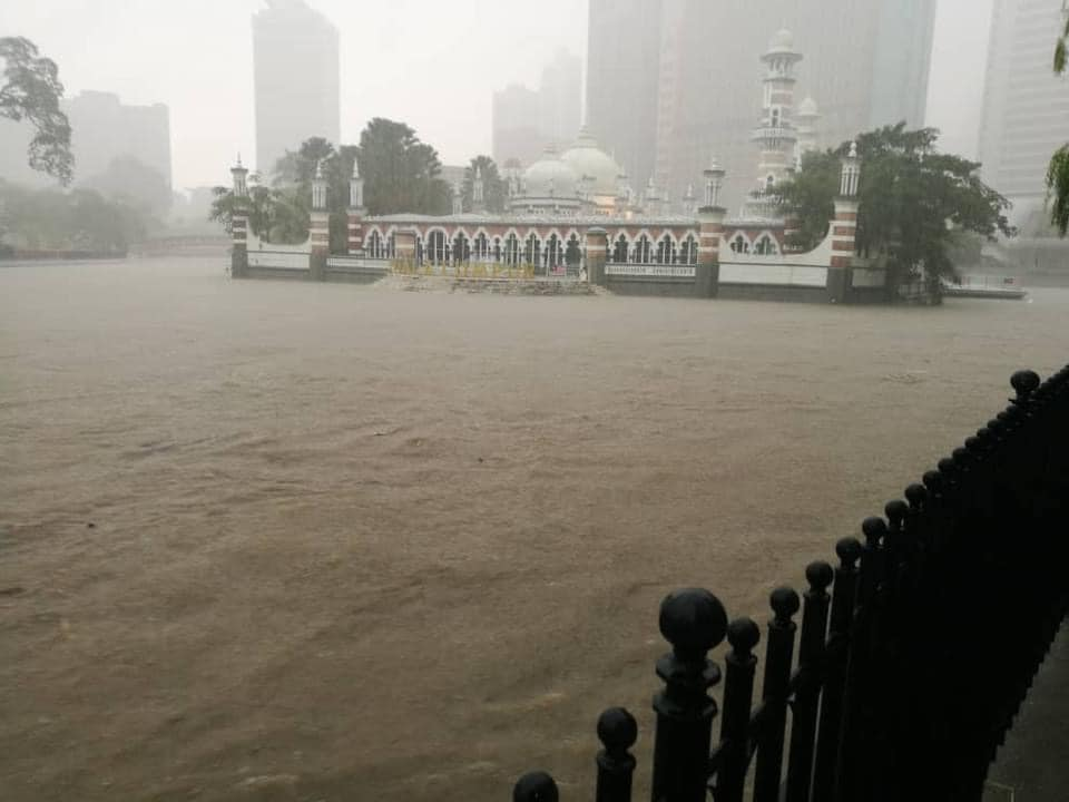Heavy flood hits Malaysian capital; buildings and vehicles damaged. 19