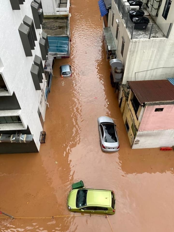 Heavy flood hits Malaysian capital; buildings and vehicles damaged. 62