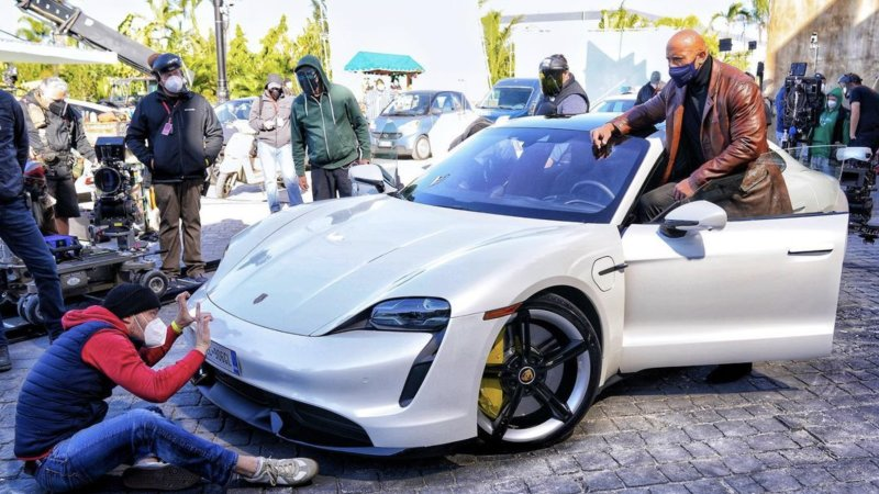 The Rock finds himself unable to fit into a Porsche Taycan 97
