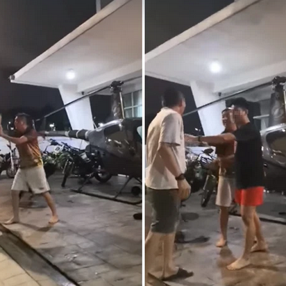 2 Malaysian men got into a fight over a helicopter parked in front of a house 63